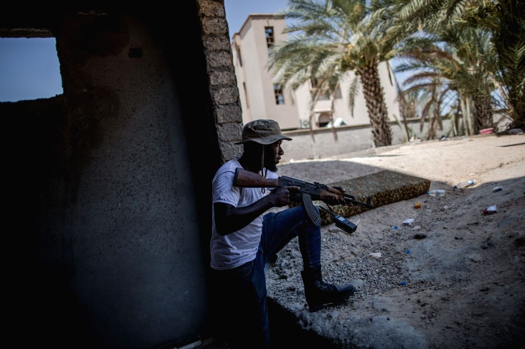 TRIPOLI, Aug. 13, 2019 - A UN-backed Government of National Accord (GNA) fighter takes position at Al-Yarmook frontline in Tripoli, Libya, on Aug. 12, 2019. Libya's UN-backed government on Sunday ...
