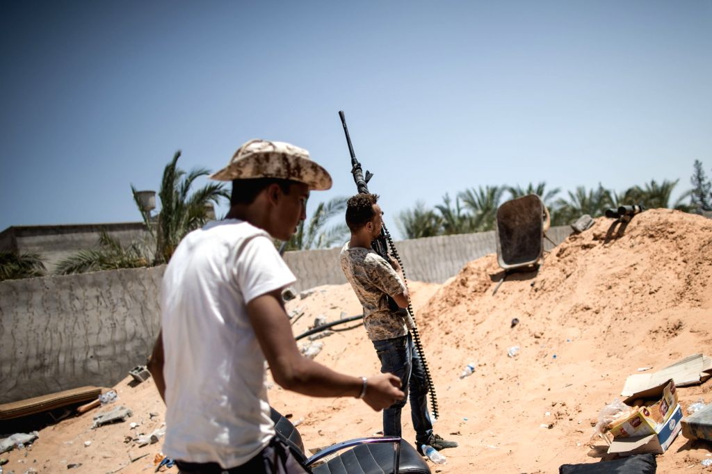 TRIPOLI, Aug. 13, 2019 - UN-backed Government of National Accord (GNA) fighters are seen at Al-Yarmook frontline in Tripoli, Libya, on Aug. 12, 2019. Libya's UN-backed government on Sunday accused ...