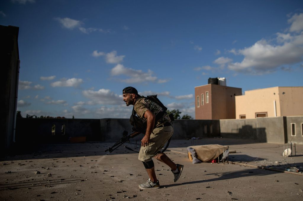 TRIPOLI, Aug. 16, 2019 - A fighter of the UN-backed Government of National Accord (GNA) is seen at a frontline in Tripoli, Libya, on Aug. 16, 2019. Since early April, the UN-backed Government of ...