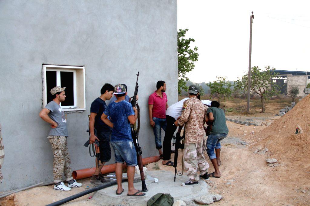 Islamic militiamen are seen during a clash near Tripoli International Airport, in Tripoli, Libya, on Aug. 2, 2014. Clashes between rival militias in the Libyan ...