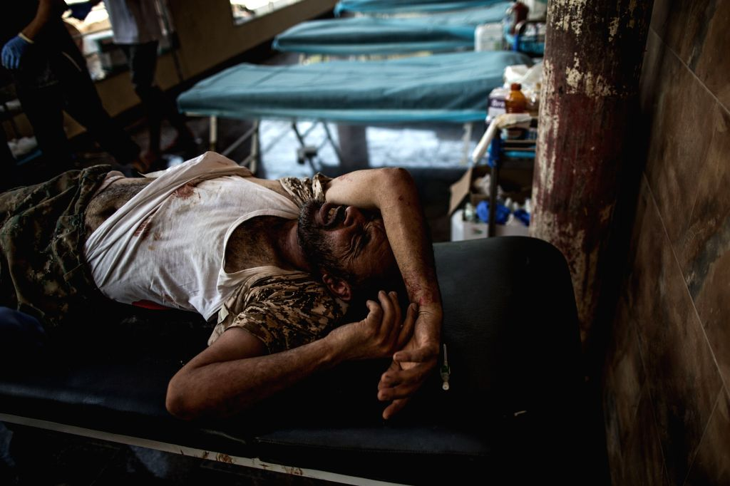 TRIPOLI, Aug. 2, 2019 - A wounded fighter of Libya's UN-backed Government of National Accord (GNA) receives medical treatment at a field hospital during clashes at the Salah al-Din frontline in ...