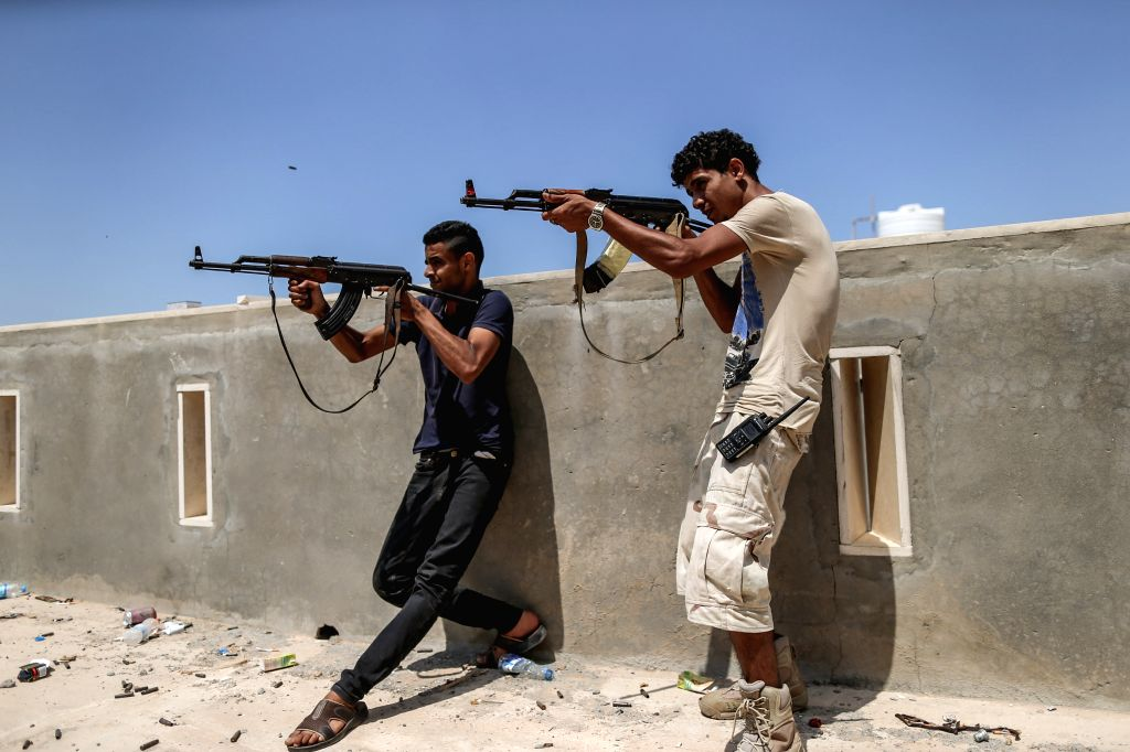 TRIPOLI, Aug. 24, 2019 - Fighters of the UN-backed Government of National Accord (GNA) fire at the east-based Libyan National Army (LNA) troops at a frontline in Tripoli, Libya, on Aug. 24, 2019. ...