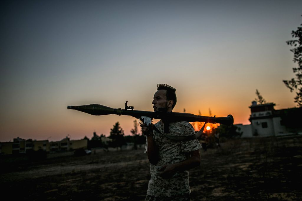 TRIPOLI, Aug. 25, 2019 - A fighter of Libya's UN-backed Government of National Accord (GNA) is seen during clashes with forces of the east-based Libyan National Army (LNA), at the Al-Yarmook ...