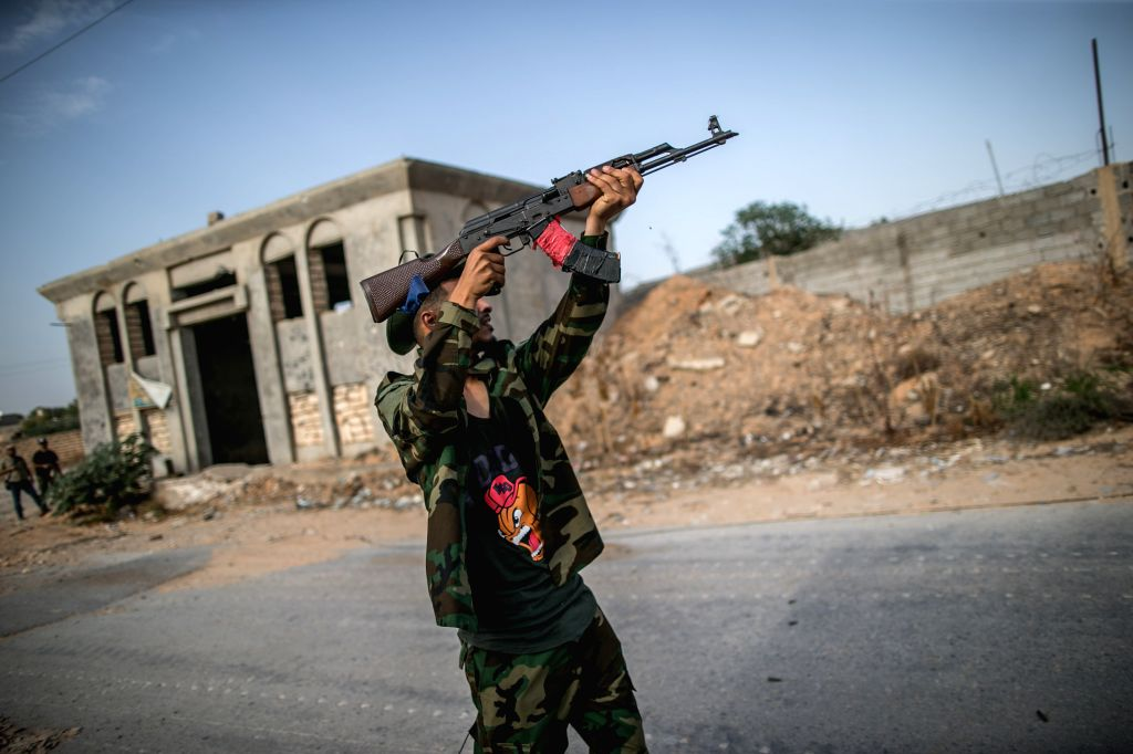TRIPOLI, Aug. 29, 2019 - A fighter of Libya's UN-backed Government of National Accord fires during clashes with the east-based Libyan National Army (LNA) at the Al-Yarmook frontline in Tripoli, ...