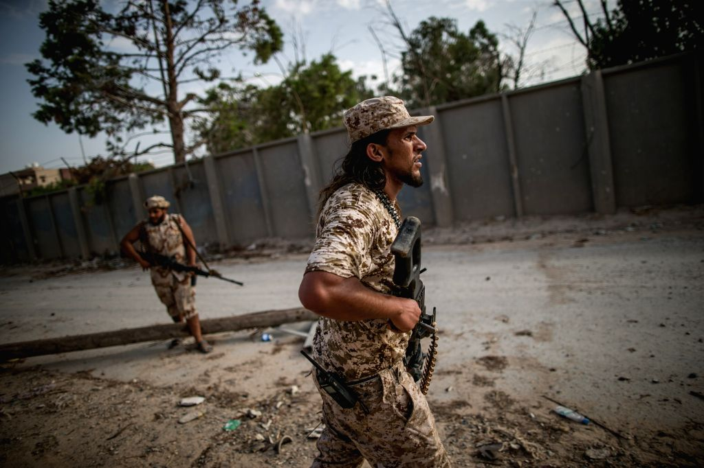 TRIPOLI, Aug. 29, 2019 - Fighters of Libya's UN-backed Government of National Accord are seen during clashes with the east-based Libyan National Army (LNA) at the Al-Yarmook frontline in Tripoli, ...