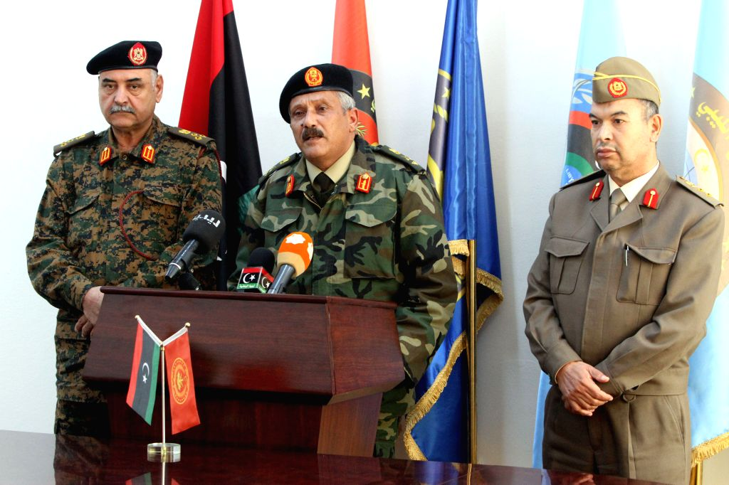 Major-General Abdessalem Jadallah al-Obeidi (C), chief of the expired General National Congress's army attends a news conference in Tripoli, Libya, Dec. 17, 2014. ..