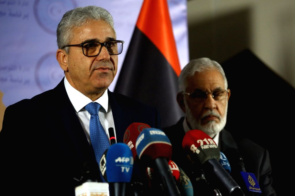 TRIPOLI, Dec. 25, 2018 (Xinhua) -- Libyan Interior Minister Fathi Bashagha (L) delivers a speech following a terrorist attack on the headquarters of Libyan Foreign Ministry in Tripoli, Libya, on Dec. 25, 2018. Libya's UN-backed government on Tuesday  - Fathi Bashagha