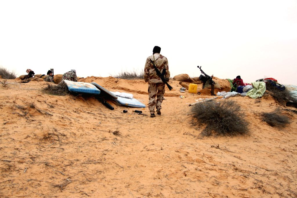 Some Libya Dawn fighters have a rest during clashes with pro-government forces near Wetia airbase, Libya, on Dec. 29, 2014. Clashes continued between Libya Dawn ...