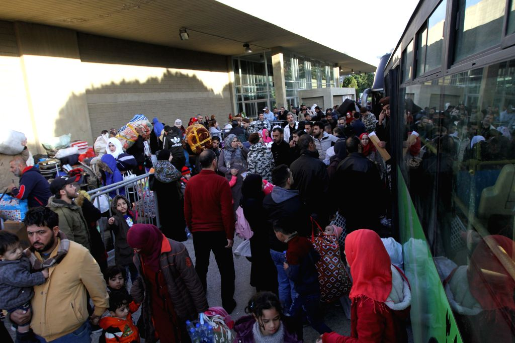 TRIPOLI, Dec. 3, 2019 - Syrian refugees take buses on a return trip to their homeland from Lebanon's northern city Tripoli on Dec. 3, 2019. Another group of Syrian refugees returned to their homeland ...