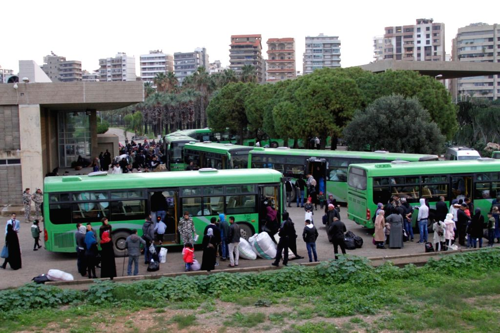 TRIPOLI, Dec. 6, 2018 - Syrian refugees get on buses to return to their homeland, in Tripoli, Lebanon, Dec. 6, 2018. Over 1,000 Syrian refugees returned Thursday to their homeland from different ...