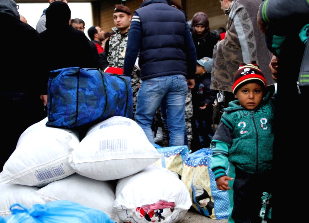TRIPOLI, Dec. 6, 2018 - Syrian refugees wait to return to their homeland, in Tripoli, Lebanon, Dec. 6, 2018. Over 1,000 Syrian refugees returned Thursday to their homeland from different areas in ...