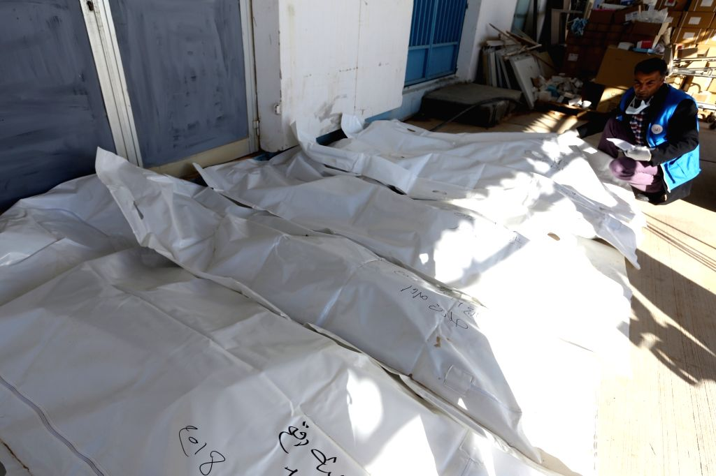 TRIPOLI, Feb. 14, 2018 - Bodies of illegal immigrants are seen at a hospital in the city of Bani Walid, some 180 km southeast of Tripoli, capital of Libya, on Feb. 14, 2018. A truck carrying illegal ...