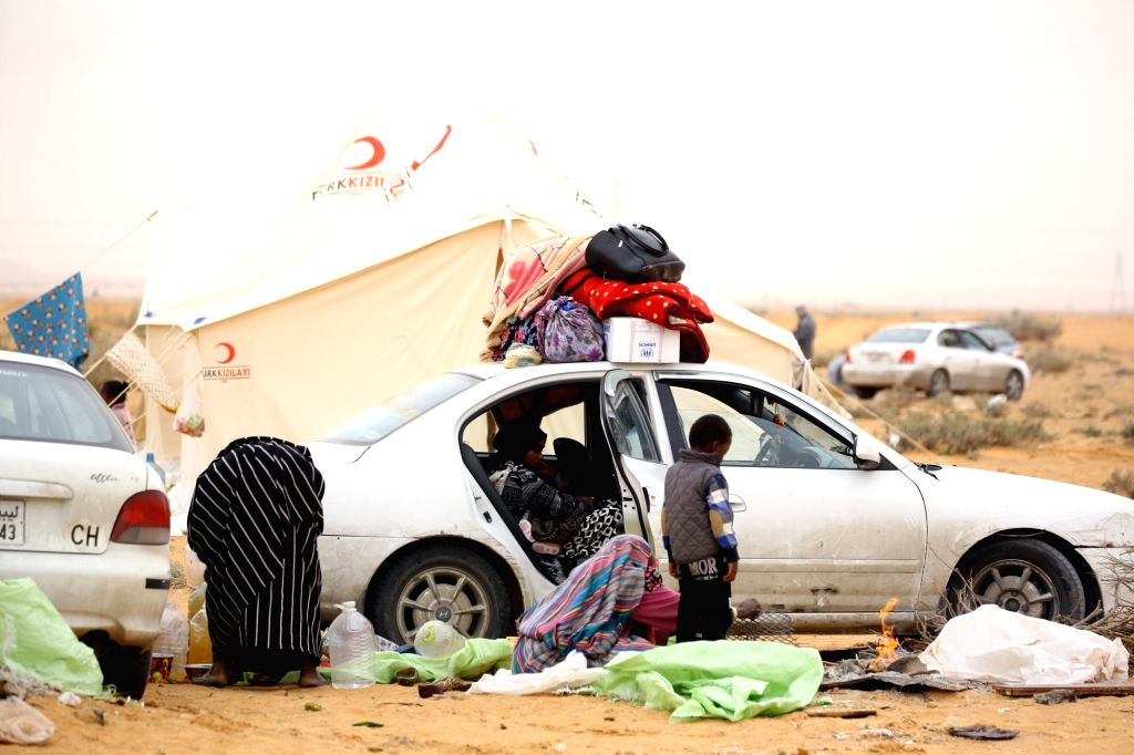 TRIPOLI, Feb. 14, 2018 - Displaced Tawerghans are seen at a camp near the city of Bani Walid, some 180 km southeast of Tripoli, capital of Libya, on Feb. 8, 2018. About 200 displaced families of ...