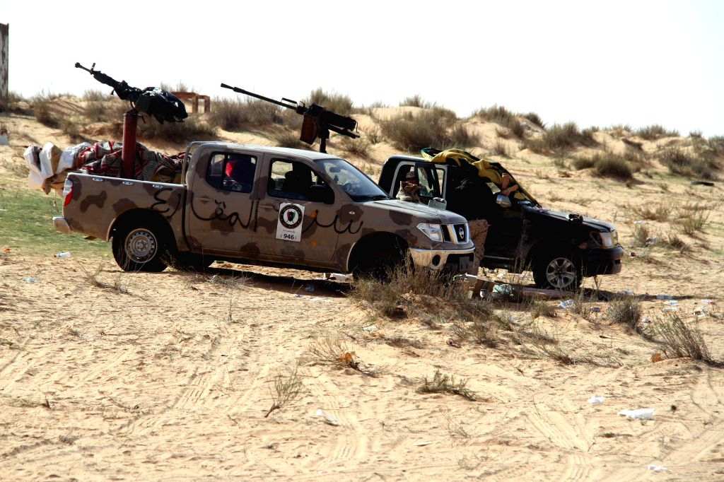Two Libya Dawn armed vehicles are parked near Wetia airbase, Libya, on Feb. 4, 2015. Clashes continued between Libya Dawn fighters and pro-government forces on ...