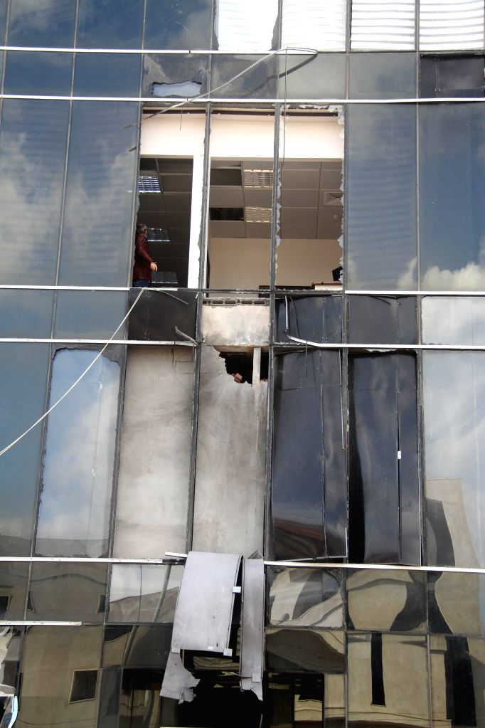 Photo taken on Jan. 9, 2015 shows the rocket attack site of al-Nabaa News TV Channel's headquarters in Tripoli, Libya. The building was hit by two rocket-propelled ..