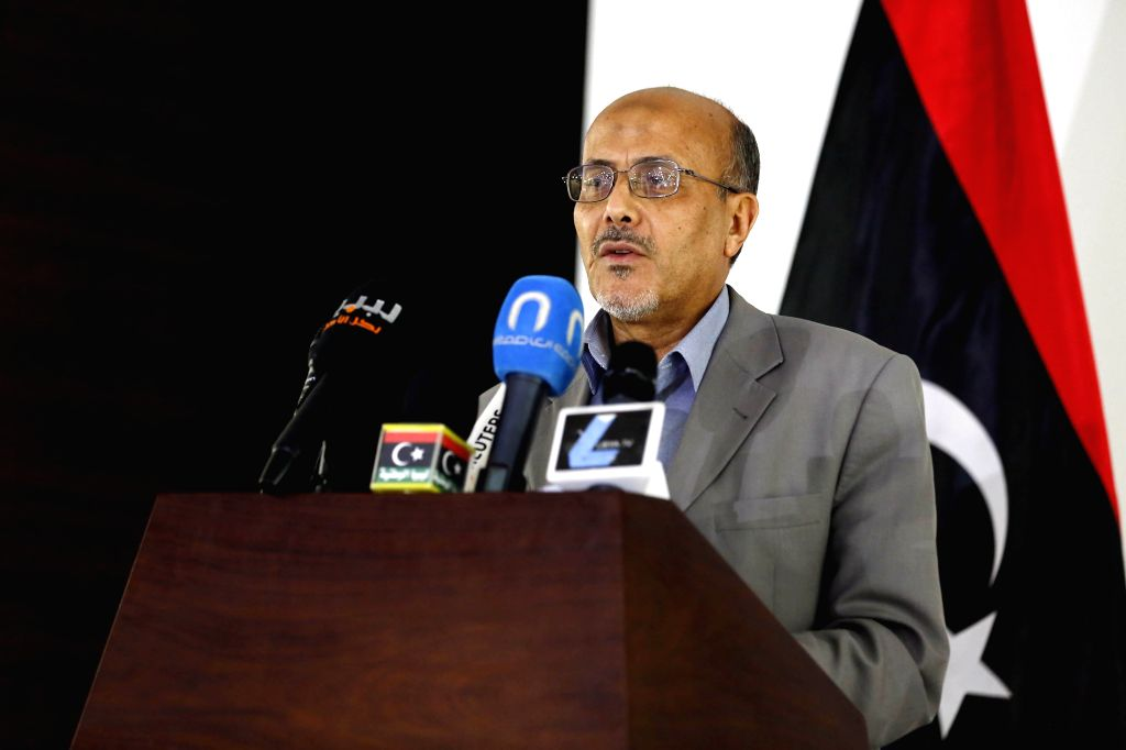 Libyan government spokesman Ahmad Lamen addresses a press conference in Tripoli, Libya, on July 15, 2014. Libya is considering international intervention to curb ...