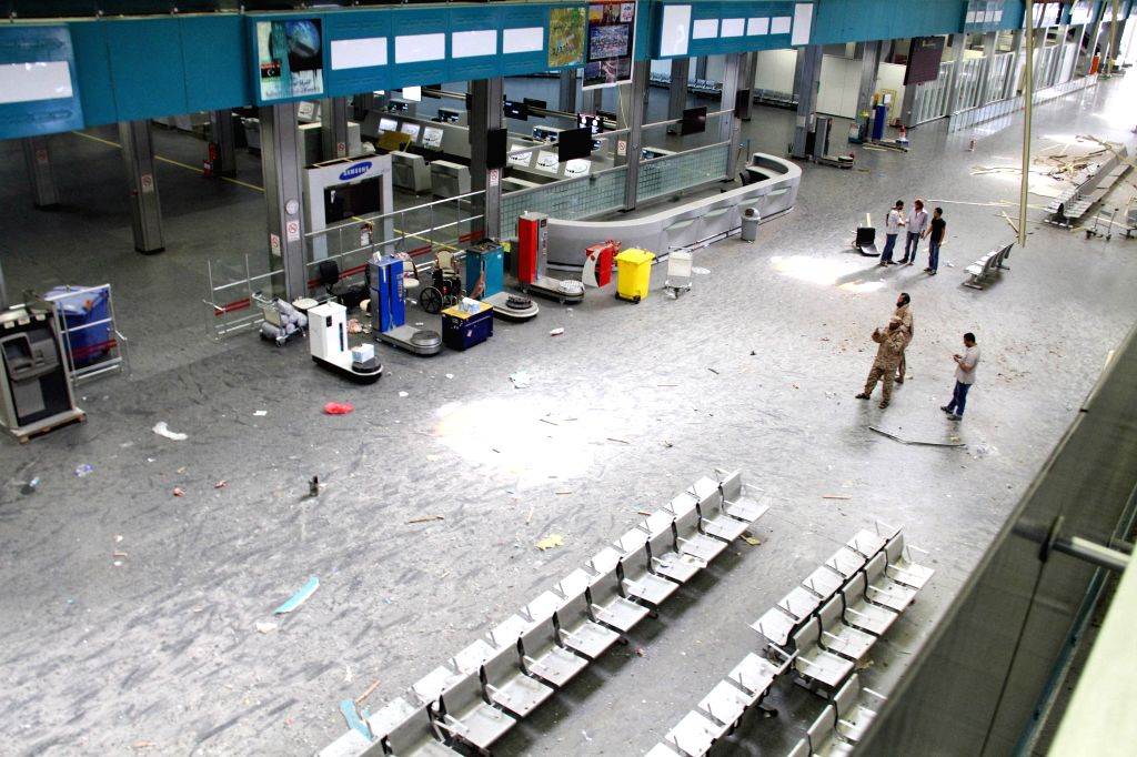 Some militias patrol in the terminal of Tripoli International Airport, in Libya, on July 17, 2014. Intense fighting has been going on in Tripoli since early Sunday .