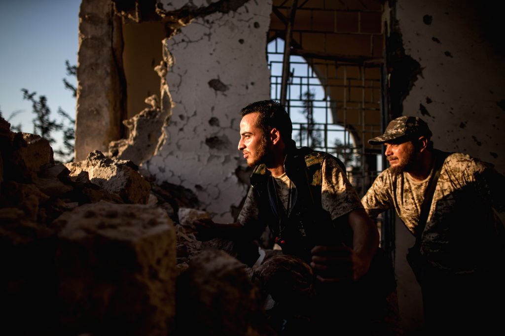 TRIPOLI, July 26, 2019 - Fighters of UN-backed Government of National Accord (GNA) take positions on the ruins of a mosque at a frontline during clashes with Libya's eastern-based army near Tripoli ...