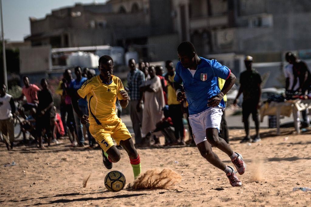 TRIPOLI, July 27, 2019 - Migrants (mainly from Chad, Niger, Mali, and Nigeria) play football as part of a self-organized league, in Souq Al-Juma'a area in Tripoli, Libya, July 26, 2019.