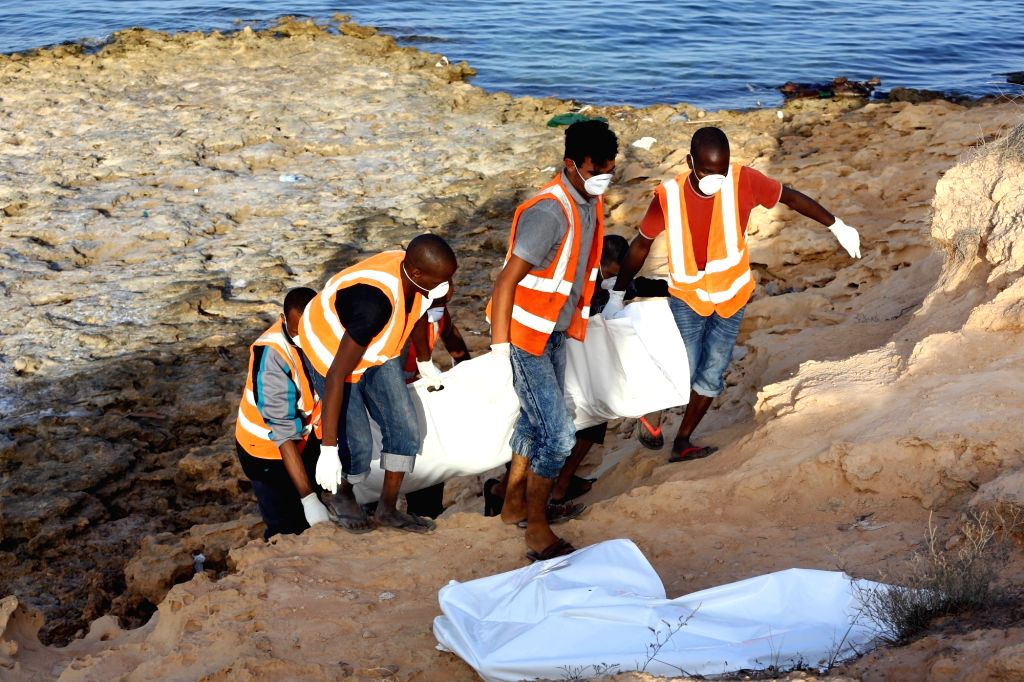 TRIPOLI, June 27, 2017 - Members of Libya's Red Crescent carry bodies of drowned migrants, in Tajura, a coastal suburb of Tripoli, capital of Libya, on June 27, 2017. The bodies of at least 25 ...