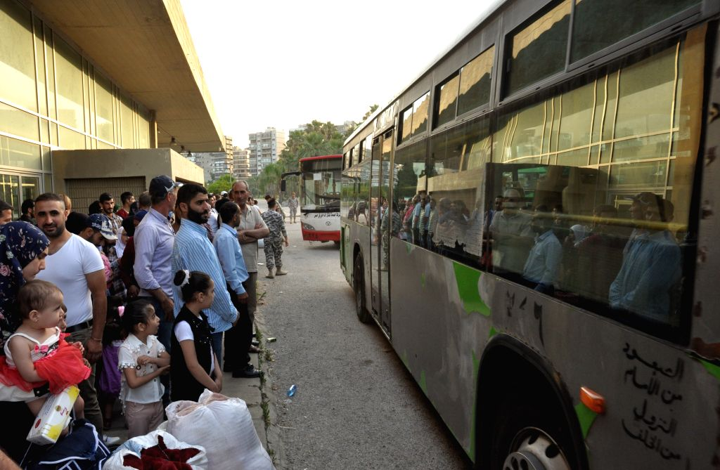 TRIPOLI (LEBANON), June 1, 2019 Syrian refugees are to take buses to return to their homeland in Lebanon's northern city Tripoli, on June 1, 2019. About 621 Syrian refugees, who gathered ...