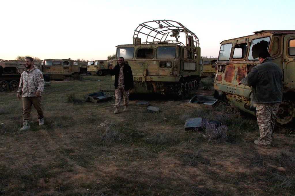 Some Libya Dawn fighters takes a rest behind some deserted trucks near Libya's capital city of Tripoli, on March 11, 2015. Clashes erupted on Wednesday between ...
