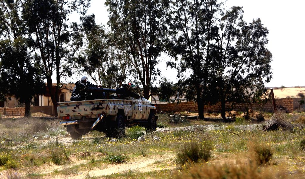 TRIPOLI, March 12 A Libya Dawn fighter sits on an armored vehicle after a fierce battle near Libya's capital city of Tripoli, on March 12, 2015. Clashes erupted on Thursday between Libya ...