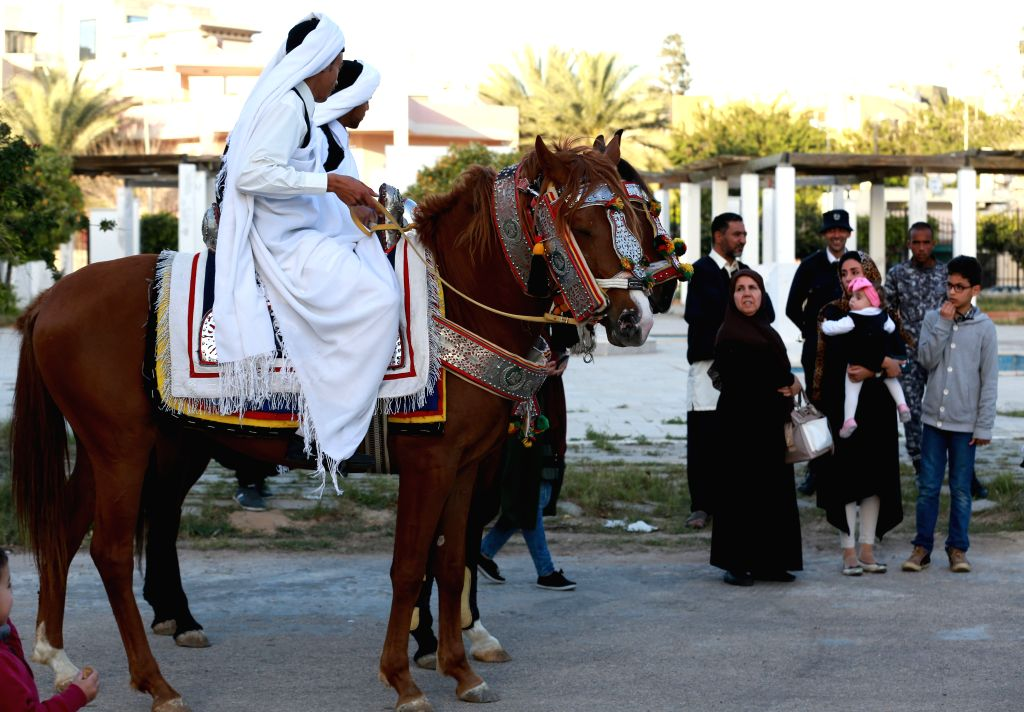 """TRIPOLI, March 13, 2017 - Libyans dressed in traditional costumes attend an event to mark the """"National Day of Traditional Dress"""" at Martyrs' Square in Tripoli, capital of Libya, on March ..."""