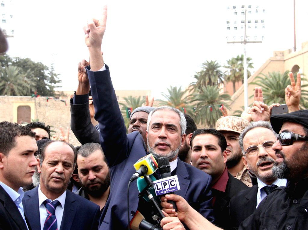 Prime Minister of Libya's Islamist-backed government Omar al-Hassi addresses a funeral in Tripoli, Libya, on March 22, 2015. Al-Hassi attended the funeral Sunday ...