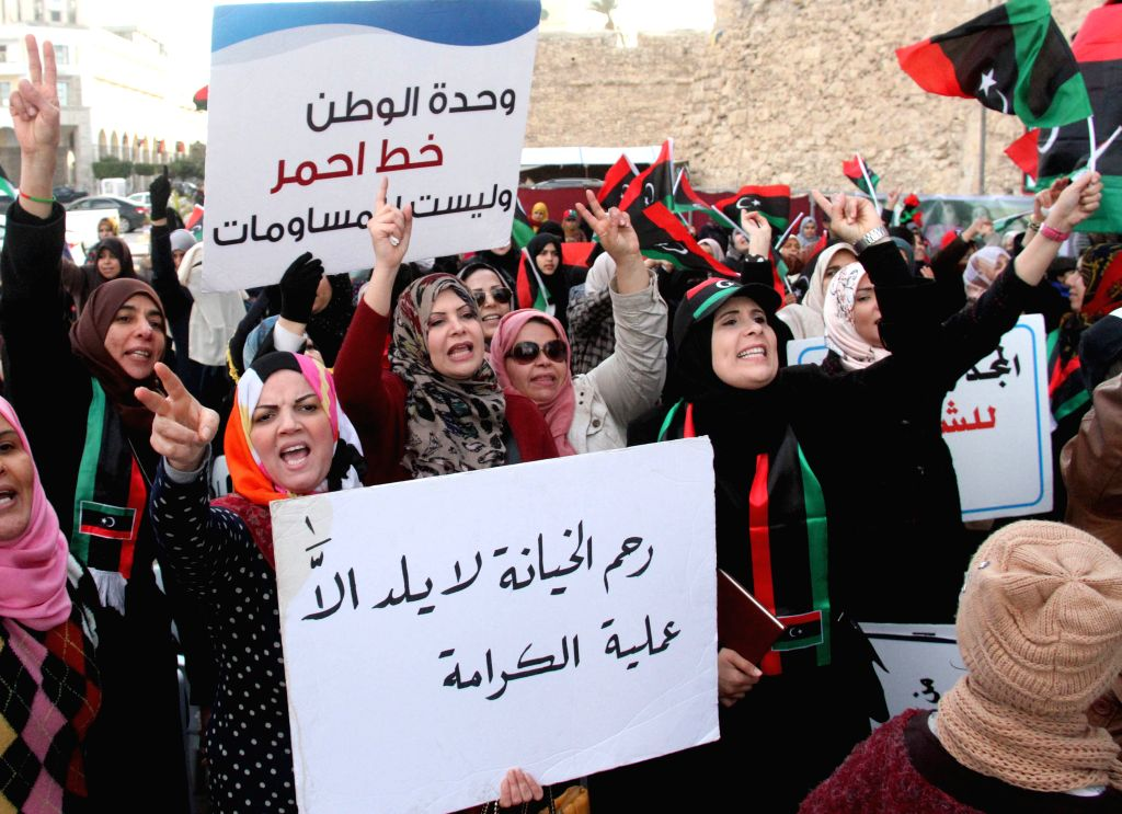 Some Tripoli citizens wave national flags and chant slogans on Martyrs Square in Tripoli, Libya, on March 6, 2015. Hundreds of Tripoli citizens demonstrated on ...