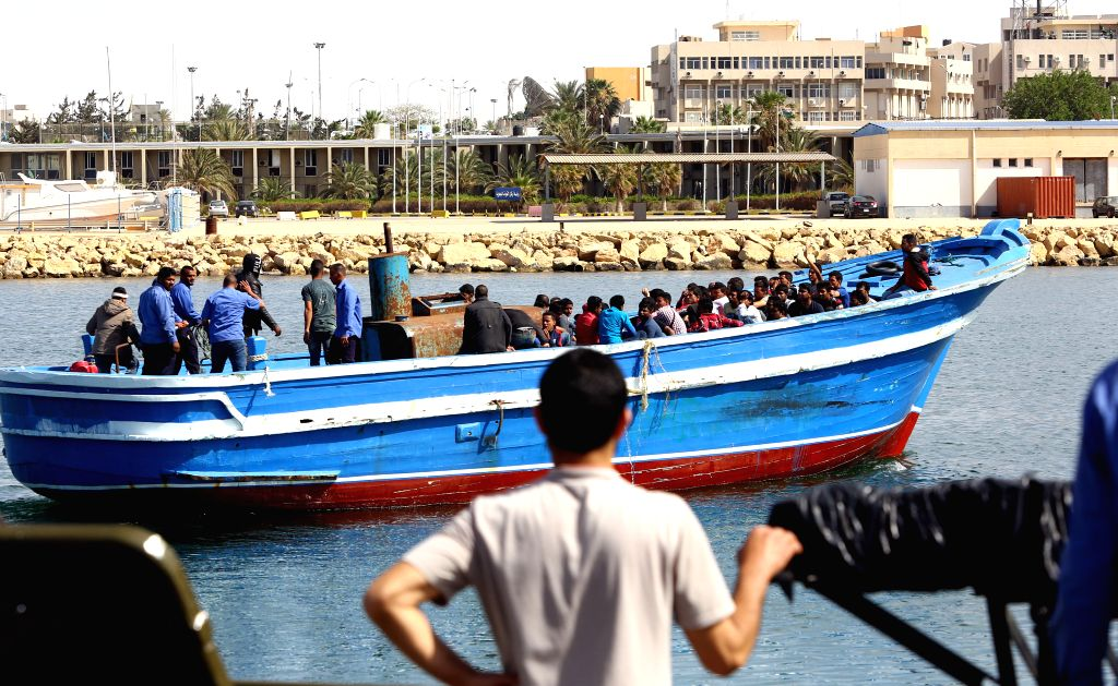 TRIPOLI, May 10, 2017 - Migrants are seen on a boat upon their arrival in Tripoli, capital of Libya, on May 10, 2017. Libyan navy on Wednesday rescued more than 300 migrants off the coast of Sabratha ...