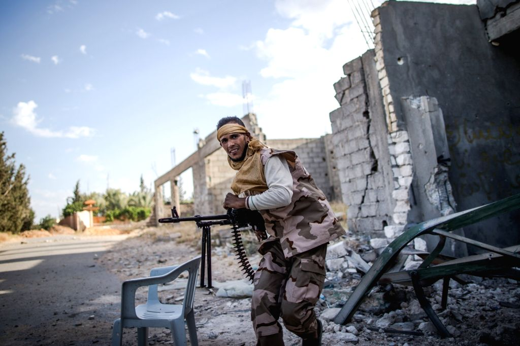 TRIPOLI, May 13, 2019 - A fighter from forces of the UN-backed Libyan government is seen during clashes with Libyan National Army (LNA) troops at the Al-Yarmook frontline in Tripoli, Libya, on May ...