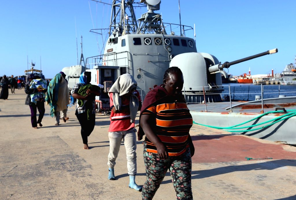 TRIPOLI, Oct. 11, 2017 - Immigrants arrive at a naval base after they were rescued by Libyan coast guards in Tripoli, Libya, on Oct. 11, 2017. Libyan coast guards on Wednesday rescued 74 illegal ...