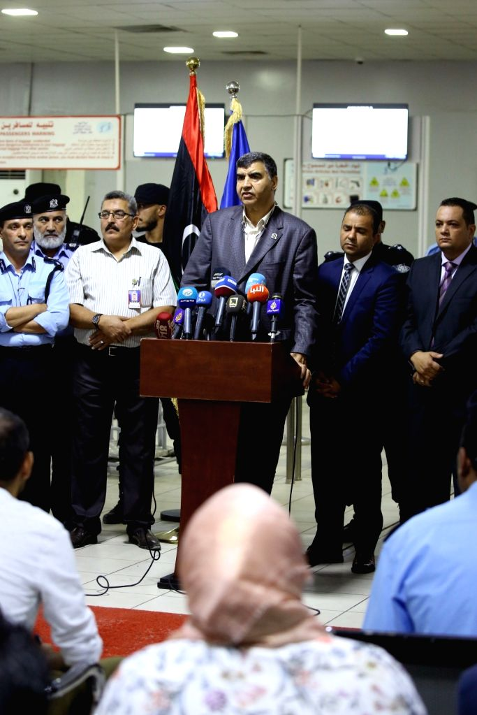 TRIPOLI, Sept. 17, 2018 - Libya's Interior Minister Abdussalam Ashour (C) speaks at a press conference in Tripoli, Libya, Sept. 17, 2018. Regular security forces will be re-deployed to secure Mitiga ... - Abdussalam Ashour