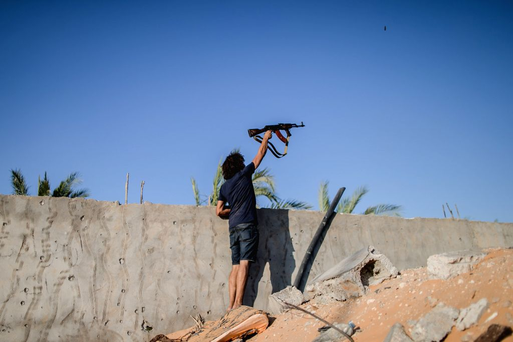 TRIPOLI, Sept. 2, 2019 - A fighter of the UN-backed Government of National Accord (GNA) fires at the east-based Libyan National Army (LNA) troops during clashes at the Al-Yarmouk frontline in ...