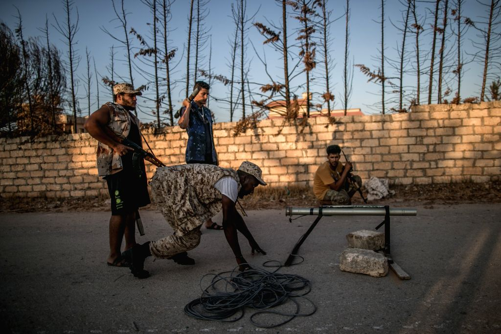TRIPOLI, Sept. 2, 2019 - Fighters of the UN-backed Government of National Accord (GNA) prepare to fire at the east-based Libyan National Army (LNA) troops during clashes at the Al-Yarmouk frontline ...