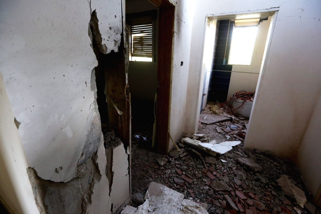 TRIPOLI, Sept. 4, 2018 - Photo taken on Sept. 4, 2018 shows the interior of a house damaged by a rocket in the area of Ein Zara, southern Tripoli, Libya. Southern Tripoli has been witnessing violent ...