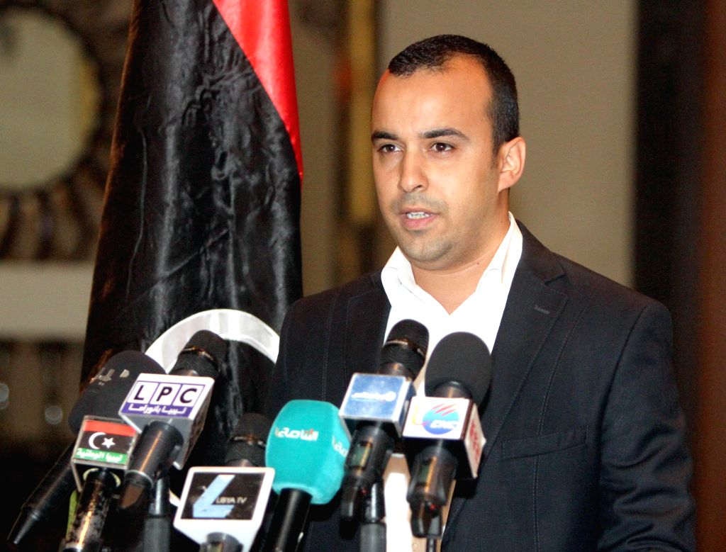 Ala Hweik, spokesperson for the Islamist armed alliance Libya Dawn, addresses a press conference in Tripoli, Libya, on Sept. 7, 2014. Hweik on Sunday called on ...