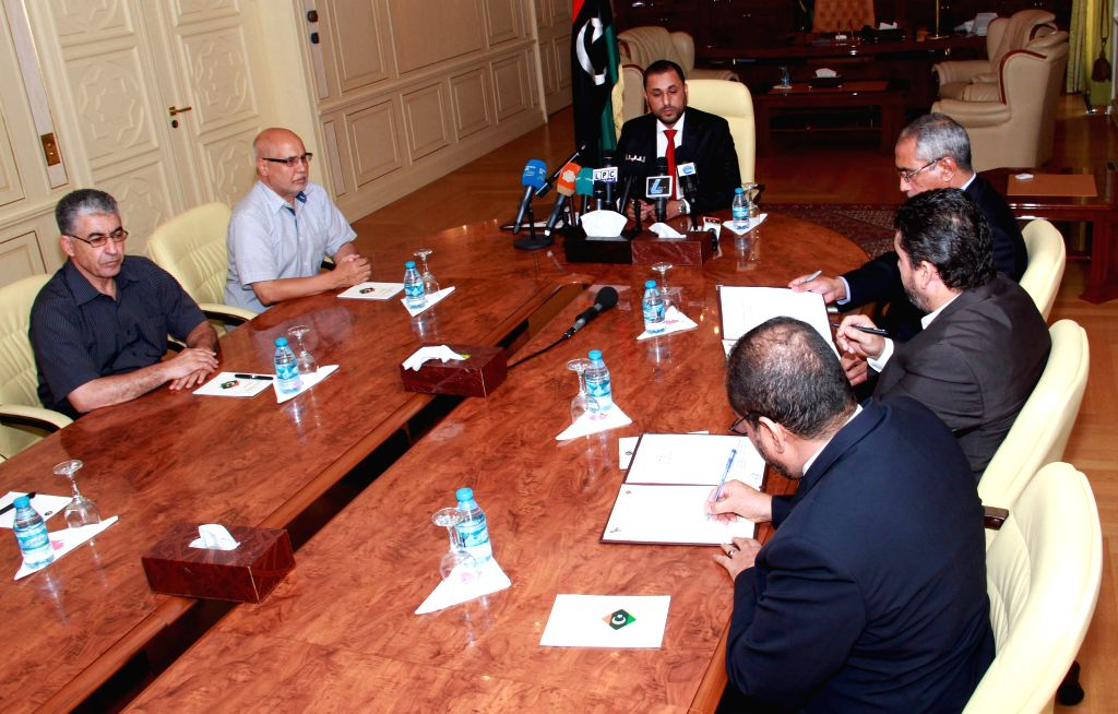 TRIPOLI, Sept. 9 Libya's Islamist-backed Prime Minister Omar al-Hasi (C) addresses a meeting after the outgoing General National Congress (GNC) granted trust to the new cabinet, which is . - Omar