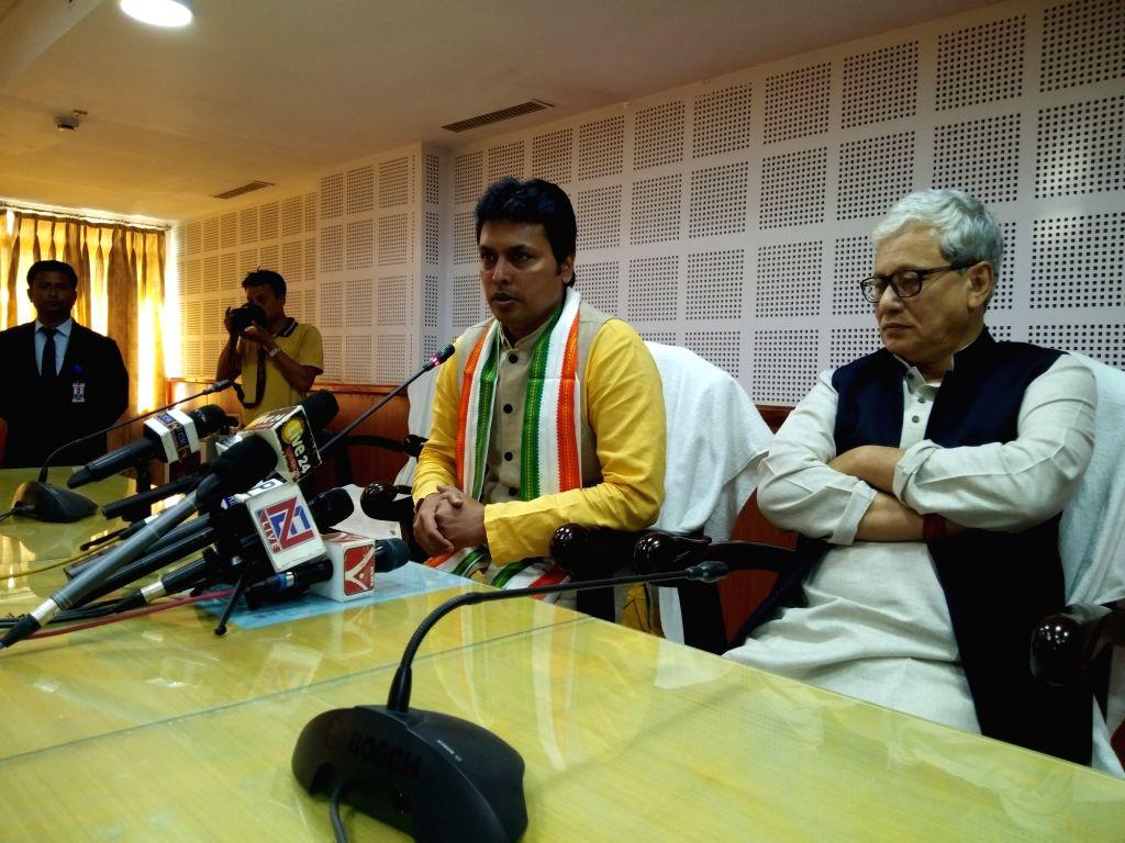 Tripura Chief Minister Biplab Kumar Deb addresses a press conference in Agartala on Feb 13, 2019. Also seen Deputy Chief Minister Jishnu Debbarma. - Biplab Kumar Deb