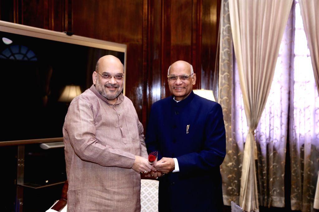 Tripura Governor Ramesh Bais meets Union Home Minister Amit Shah, in New Delhi on Aug 9, 2019. - Amit Shah
