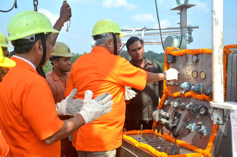 Tripura Governor Tathagata Roy (middle) switching on the ONGC rig in Kunjaban field in western Tripura. ONGC Executive Director S. C. Soni (behind governor) looks on. - Tathagata Roy