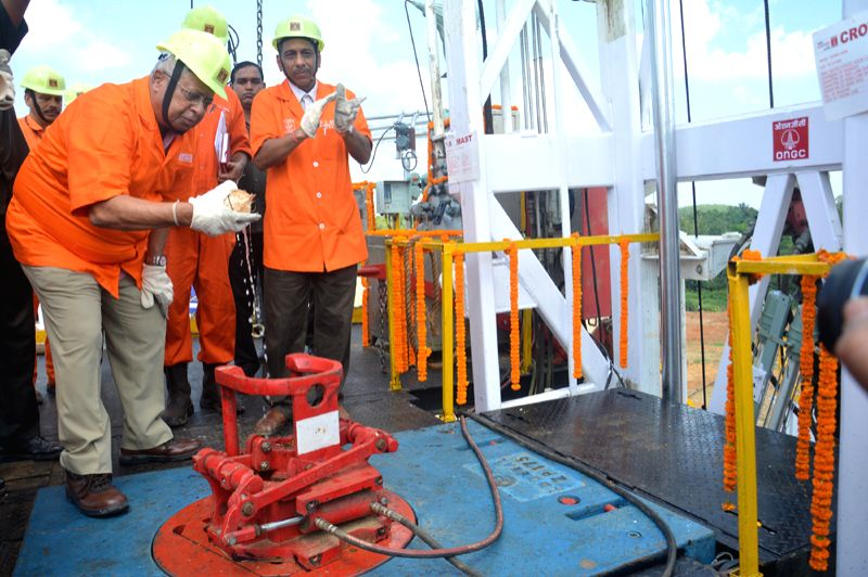 Tripura Governor Tathagata Roy (middle) switching on the ONGC rig in Kunjaban field in western Tripura. ONGC Executive Director S. C. Soni (left side of governor) looks on. - Tathagata Roy