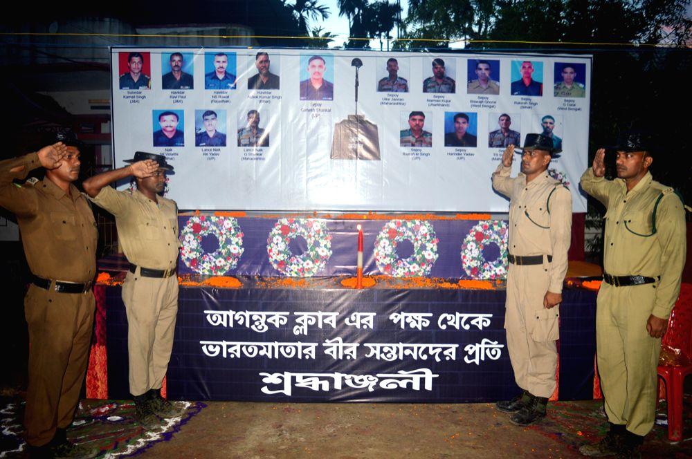Tripura State Rifles Jawans saluting the Uri martyrs. Photo : Jakir Hossain