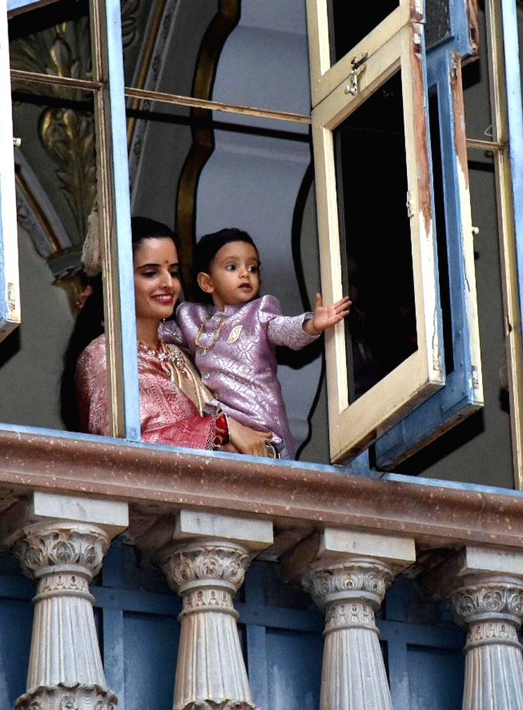Trishika Devi, wife of Yaduveer Krishnadatta Chamaraja Wadiyar with their son Aadyaveer Narasimharaja Wadiyar during Ayudha Pooja at Mysore Palace on Oct 7, 2019.