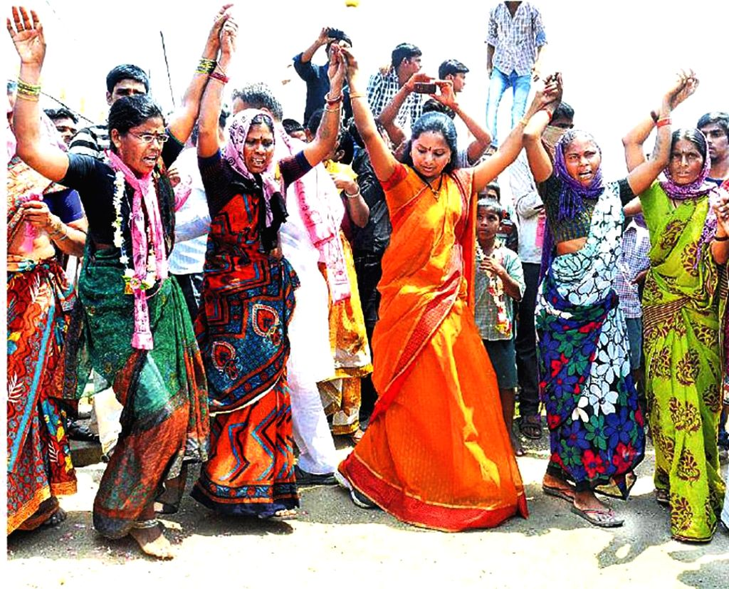 TRS candidate for 2014 Lok Sabha Election from Nizamabad K. Kavitha dances with villagers during an election campaign in Nizamabad on April 15, 2014.