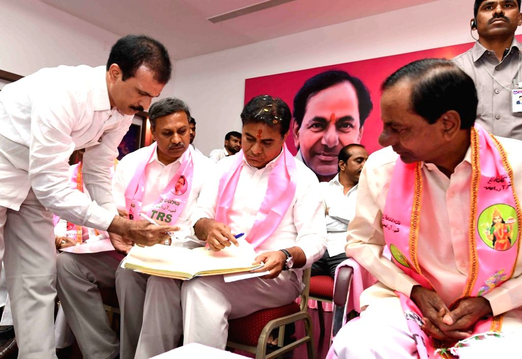 TRS leader K. T. Rama Rao takes blessings of his father and party chief K. Chandrashekhar Rao  after assuming charge as party's working president in Hyderabad on Dec 14, 2018.
