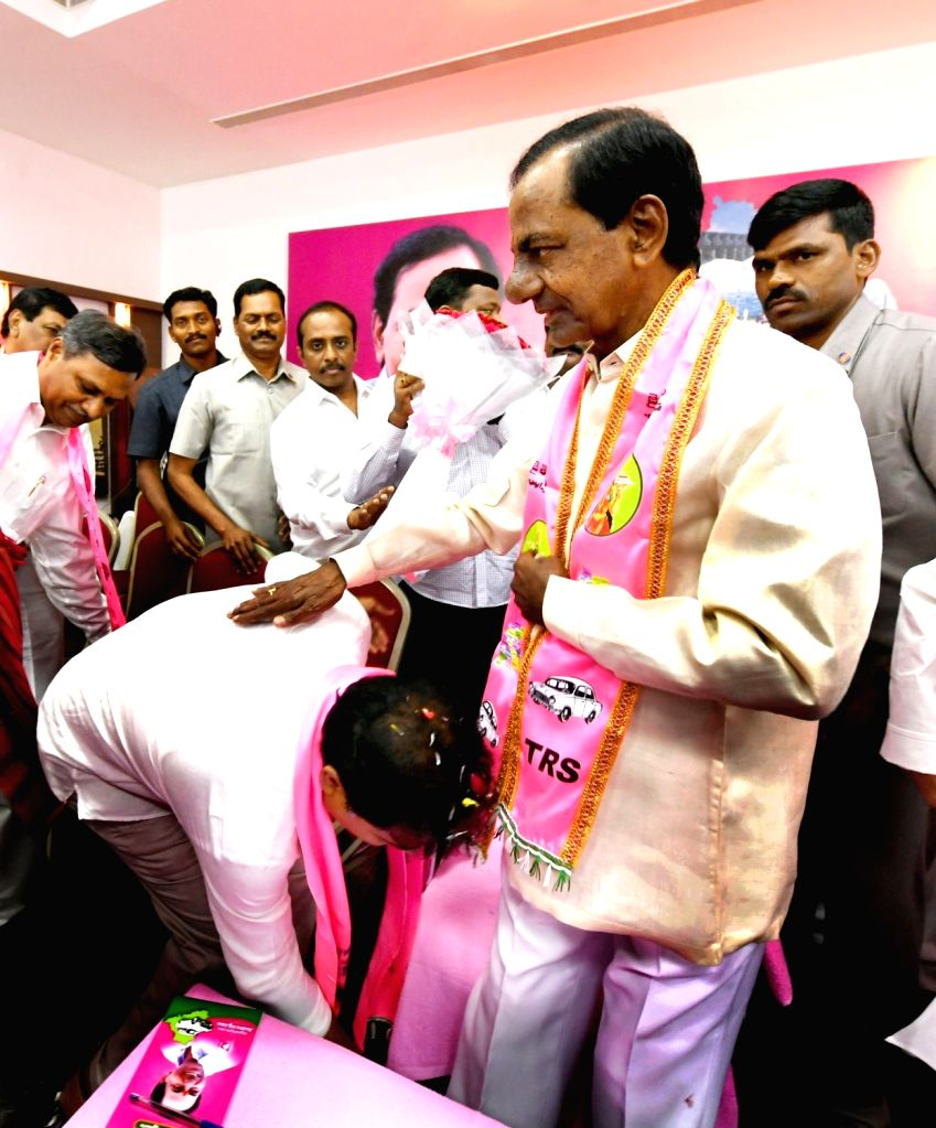 TRS leader K. T. Rama Rao takes charge as party's working president in presence of his father and party chief K. Chandrashekhar Rao  in Hyderabad on Dec 14, 2018.