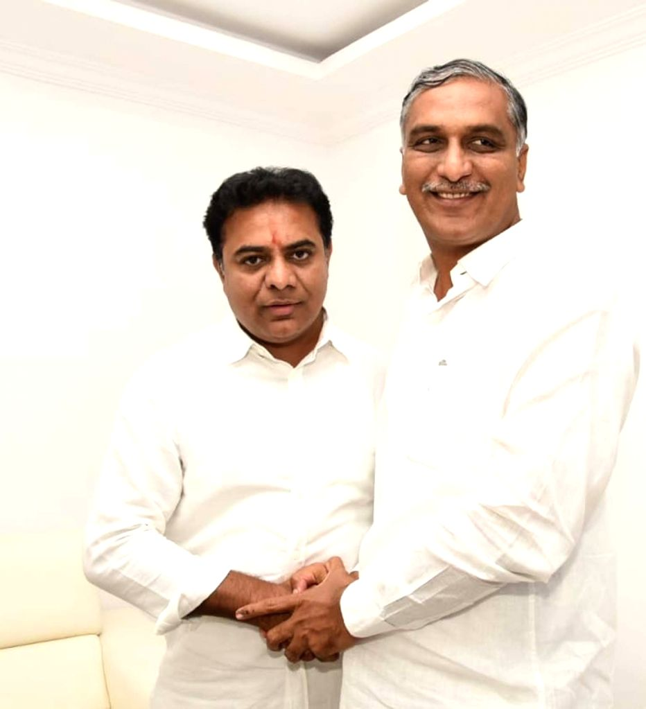 TRS leader T Harish Rao with K. T. Rama Rao who has been appointed party's working president in Hyderabad on Dec 14, 2018. - T Harish Rao