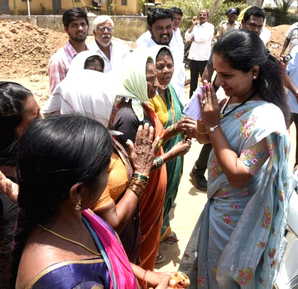 TRS MP from Nizamabad, K. Kavitha meets voters at a polling station during elections to the first phase of the three-phased Mandal Parishad Territorial Constituencies (MPTC) and Zilla ...